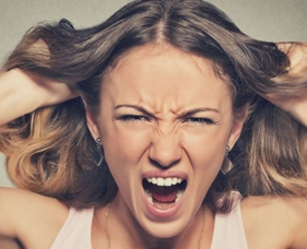 46737941 - closeup portrait stressed, frustrated angry woman pulling hair out yelling screaming temper tantrum isolated on grey wall background. negative human emotion facial expression reaction attitude