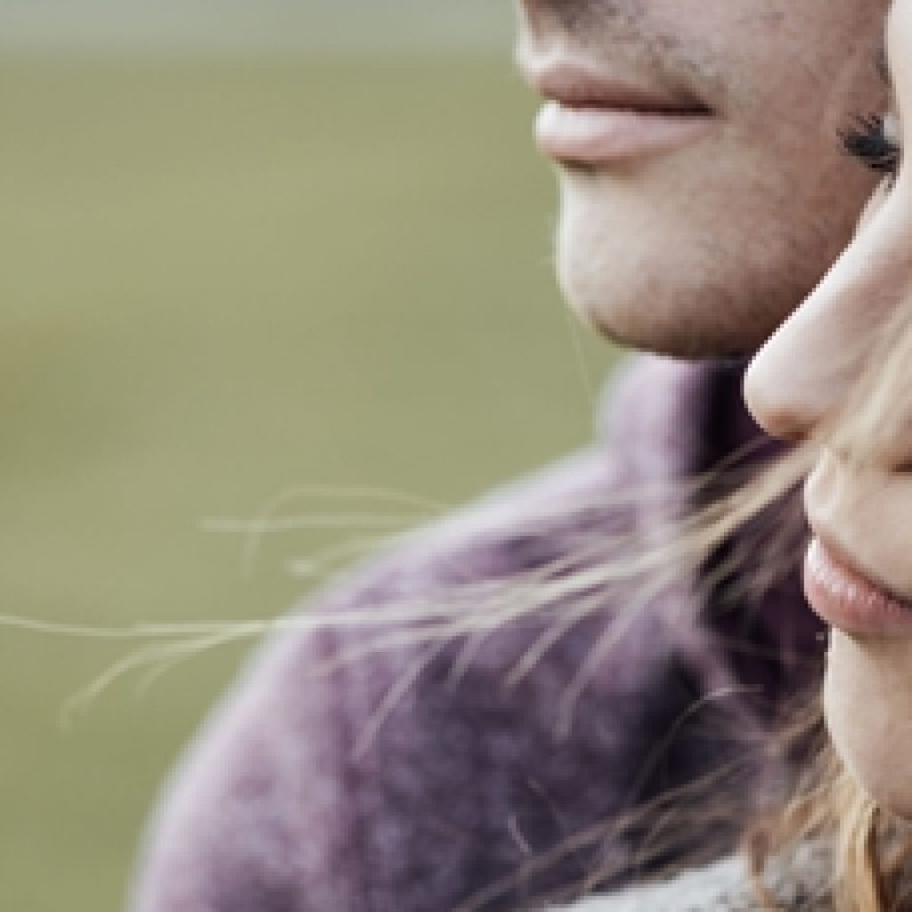 49695767 - young loving couple outdoors sitting on grass, hugging and looking away, future and relationships concept